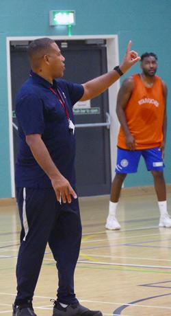 karl-brown-explaining-offense-coaching-basketball-england-mens-div-1-gateway-college
