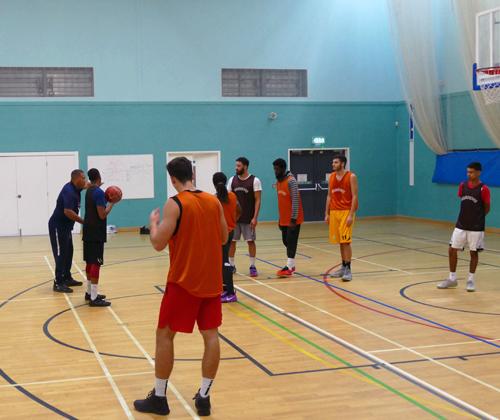 karl-brown-explaining-offense-coaching-basketball-england-mens-div-1